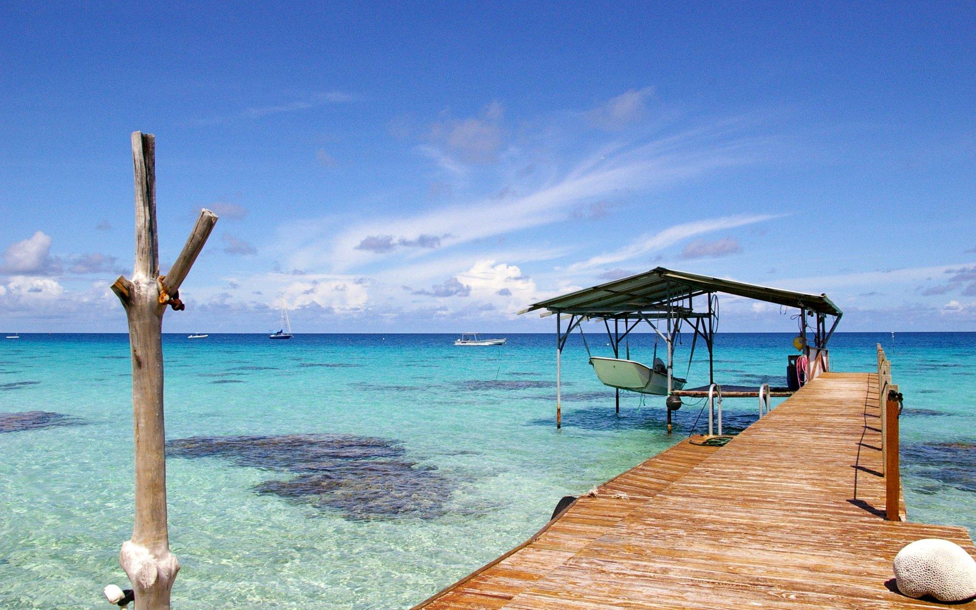 Деревянная пристань с лодкой и море, тематика обоев - море, обои для рабочего стола - РАЗМЕР: 1280x1024px.